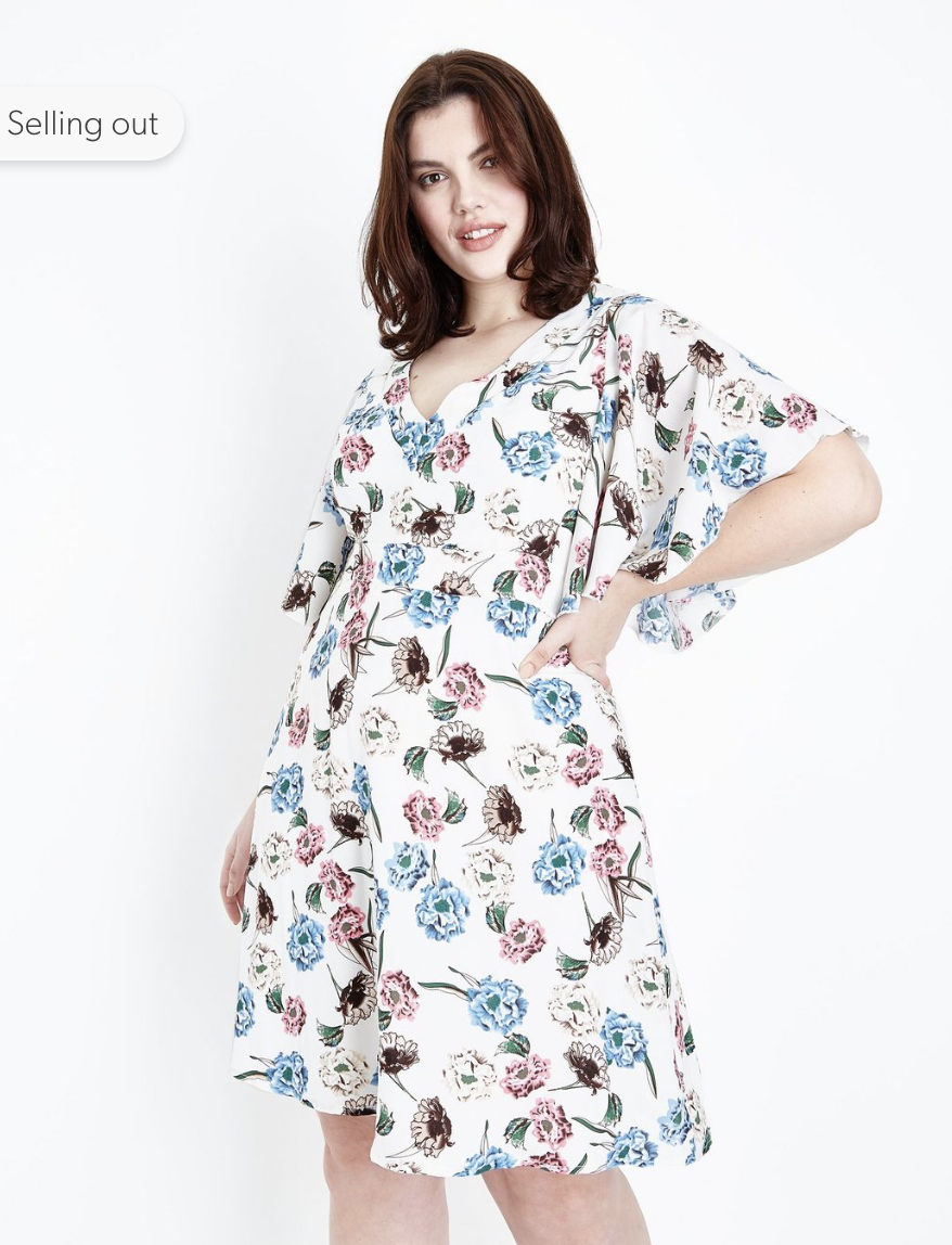 0ee2b1ccd64 These sleeves accentuate the floaty hem of the dress and when combined with  the floral print, make a truly pretty plus size dress for this summer.